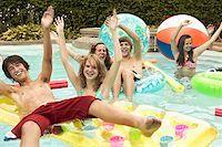 Teenagers in swimming pool Stock Photo - Premium Royalty-Freenull, Code: 621-01839525