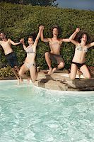 Teenagers jumping into pool Stock Photo - Premium Royalty-Freenull, Code: 621-01839558
