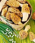 Morels in and beside woodchip basket, lilies-of-the-valley Stock Photo - Premium Royalty-Free, Artist: Beanstock Images, Code: 659-01842999