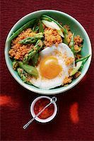 spicy - Quinoa with ajvar, green asparagus and fried egg Stock Photo - Premium Royalty-Freenull, Code: 659-01843813