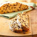 Two slices of stollen in front of stollen with slices cut Stock Photo - Premium Royalty-Free, Artist: Photocuisine, Code: 659-01844195