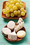 Selection of cheeses and green grapes Stock Photo - Premium Royalty-Freenull, Code: 659-01845319