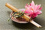 Chopsticks in woven wrapper with water lily on plate Stock Photo - Premium Royalty-Free, Artist: Cusp and Flirt, Code: 659-01845963