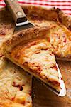 Pizza Margherita with piece on server Stock Photo - Premium Royalty-Freenull, Code: 659-01847539
