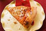 Piece of Pizza Margherita, sprinkled with Parmesan Stock Photo - Premium Royalty-Freenull, Code: 659-01847601