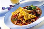 Mince ragout with baked polenta triangles Stock Photo - Premium Royalty-Freenull, Code: 659-01848517
