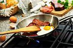 Fried egg with Black Forest ham in a frying pan Stock Photo - Premium Royalty-Free, Artist: Photocuisine, Code: 659-01849173