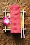 Table accessories: hand towel, chopsticks, bamboo mat & orchid Stock Photo - Premium Royalty-Free, Artist: foodanddrinkphotos, Code: 659-01849637