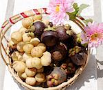 Thai gift basket of longans and mangosteens Stock Photo - Premium Royalty-Free, Artist: foodanddrinkphotos, Code: 659-01851238