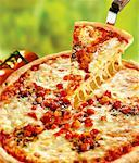 Pizza Margherita, one slice on pizza server Stock Photo - Premium Royalty-Freenull, Code: 659-01851605