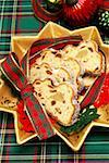 Marzipan stollen, cut up on a star-shaped plate Stock Photo - Premium Royalty-Free, Artist: foodanddrinkphotos, Code: 659-01851898