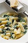 Rigatoni with spinach and cream sauce Stock Photo - Premium Royalty-Freenull, Code: 659-01854874