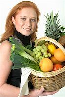 Young woman holding a basket of fruit and vegetables Stock Photo - Premium Royalty-Freenull, Code: 659-01855145