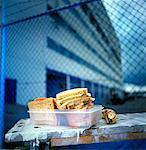 Lunch box containing cold cut sandwiches, banana Stock Photo - Premium Royalty-Free, Artist: foodanddrinkphotos, Code: 659-01855291