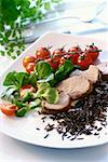 Pork fillet with wild rice, corn salad and cherry tomatoes Stock Photo - Premium Royalty-Free, Artist: Ron Fehling, Code: 659-01856726