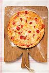 Whole pizza Margherita on chopping board Stock Photo - Premium Royalty-Freenull, Code: 659-01859923