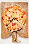 Pizza Margherita, a slice cut, on chopping board Stock Photo - Premium Royalty-Freenull, Code: 659-01859926