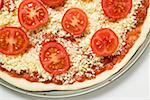 Cheese and tomato pizza (unbaked) Stock Photo - Premium Royalty-Freenull, Code: 659-01859946
