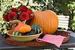 Pumpkins, squashes and flowers on table in the open air Stock Photo - Premium Royalty-Free, Artist: Jerzyworks, Code: 659-01860157