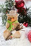 Spiced pastry snowman in winter landscape Stock Photo - Premium Royalty-Free, Artist: foodanddrinkphotos, Code: 659-01860244