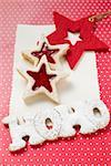 Almond biscuits & the words HOHO in gingerbread, for Xmas Stock Photo - Premium Royalty-Free, Artist: foodanddrinkphotos, Code: 659-01860271