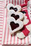 Heart-shaped biscuits with raspberry jam and icing sugar Stock Photo - Premium Royalty-Free, Artist: foodanddrinkphotos, Code: 659-01860280