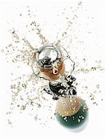 exploding - Cork flying out of a sparkling wine bottle Stock Photo - Premium Royalty-Freenull, Code: 659-01861413