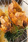 Two half roast chickens on rack above roasting tin Stock Photo - Premium Royalty-Freenull, Code: 659-01862236