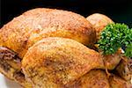 Spicy roast chicken, garnished with parsley Stock Photo - Premium Royalty-Freenull, Code: 659-01862271