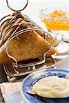 Toast in toast rack, butter, orange marmalade Stock Photo - Premium Royalty-Free, Artist: foodanddrinkphotos, Code: 659-01863972