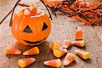 Candy corn (Halloween sweets, USA), pumpkin lantern Stock Photo - Premium Royalty-Freenull, Code: 659-01864371