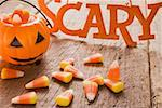 Candy corn (Halloween sweets, USA), pumpkin lantern Stock Photo - Premium Royalty-Freenull, Code: 659-01864372