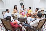 Family sitting in a room and smiling Stock Photo - Premium Royalty-Freenull, Code: 630-01872687