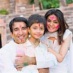 Mid adult couple with their son celebrating holi Stock Photo - Premium Royalty-Free, Artist: Photosindia, Code: 630-01873038
