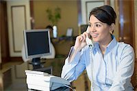 phone cord - Close-up of a businesswoman talking on the telephone and smiling Stock Photo - Premium Royalty-Freenull, Code: 630-01873187