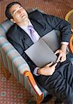 High angle view of a businessman sleeping in an armchair Stock Photo - Premium Royalty-Freenull, Code: 630-01873317
