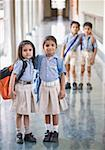 Portrait of two schoolgirls standing in a corridor Stock Photo - Premium Royalty-Freenull, Code: 630-01873761