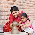 Girl with her teacher in a pottery class Stock Photo - Premium Royalty-Free, Artist: Derek Shapton, Code: 630-01873826
