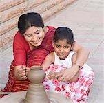 Girl with her teacher in a pottery class Stock Photo - Premium Royalty-Free, Artist: Robert Harding Images, Code: 630-01873827