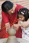Girl with her teacher in a pottery class Stock Photo - Premium Royalty-Free, Artist: Kathleen Finlay, Code: 630-01873828