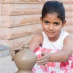 Portrait of a girl making a pottery Stock Photo - Premium Royalty-Free, Artist: Masterfile, Code: 630-01873835