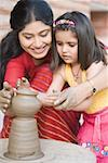 Girl with her teacher in a pottery class Stock Photo - Premium Royalty-Free, Artist: Aflo Relax, Code: 630-01873839