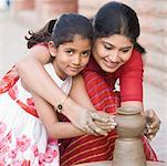 Portrait of a girl with her teacher in a pottery class Stock Photo - Premium Royalty-Free, Artist: Blend Images, Code: 630-01873841