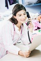 phone cord - Close-up of a female fashion designer talking on the telephone Stock Photo - Premium Royalty-Freenull, Code: 630-01874303
