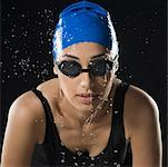 Close-up of a young woman swimming