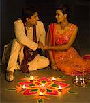 Young couple sitting behind a rangoli Stock Photo - Premium Royalty-Free, Artist: Photosindia, Code: 630-01877283