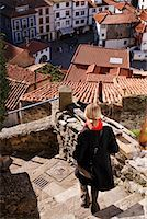 Woman Descending Stairs, Cudillero, Asturias, Spain    Stock Photo - Premium Rights-Managednull, Code: 700-01878881