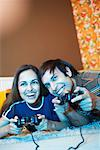 Couple Playing Video Games    Stock Photo - Premium Royalty-Free, Artist: Masterfile, Code: 600-01879513