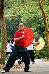 Man Practicing Tai Chi, Singapore Botanical Gardens, Singapore