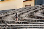 Athlete Running Up Bleacher Steps    Stock Photo - Premium Rights-Managed, Artist: Blue Images Online, Code: 700-01880227